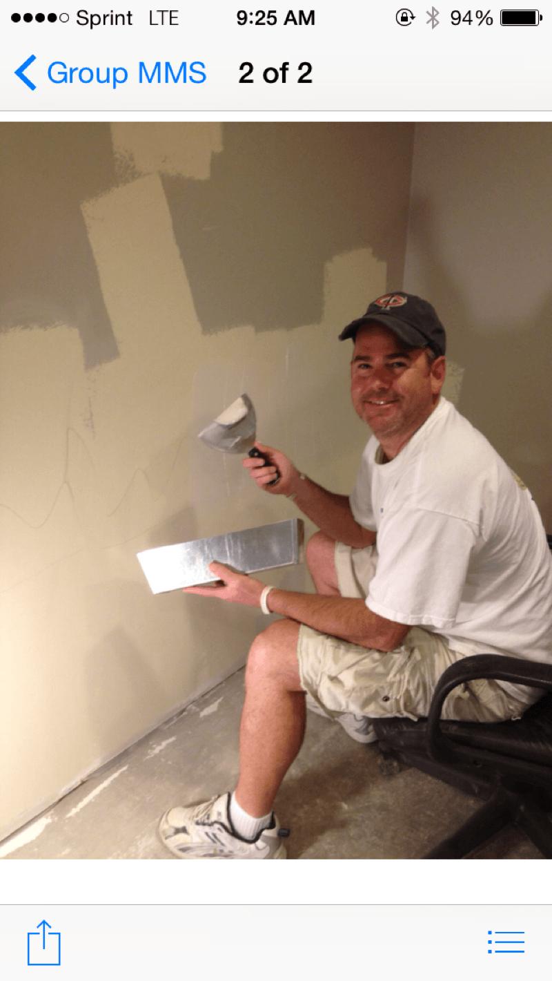 John Doing Wall Repairs